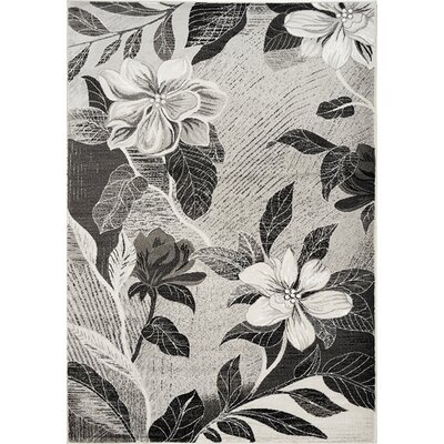 Louisa Antiqued Silver Flowers Area Rug Rug Size: 53 x 77