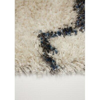 Aquirre Warm Quatrefoil Cream Area Rug Rug Size: 53 x 77