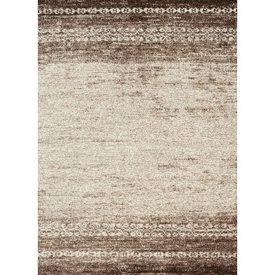 Reeves Distressed Cream & Brown Area Rug Rug Size: 53 x 77