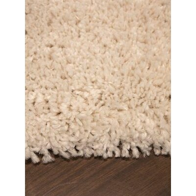 Jannie Solid Cream Soft Touch Area Rug Rug Size: 53 x 77