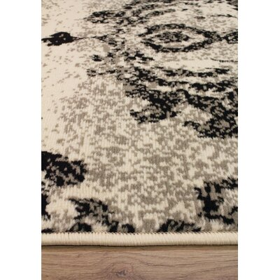 Ferrante Black/Cream Area Rug Rug Size: 67 x 96