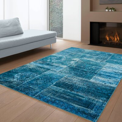 Lunceford Brilliant Teal Area Rug Rug Size: 57 x 710
