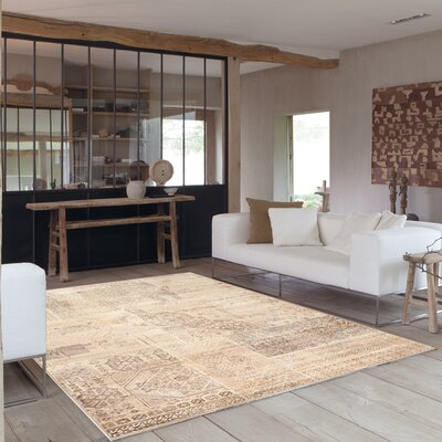 Lunceford Brilliant Beige Area Rug Rug Size: 57 x 710