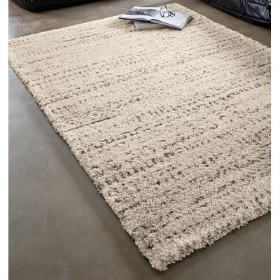 Lapeer Cream Ancients Area Rug Rug Size: 53 x 77