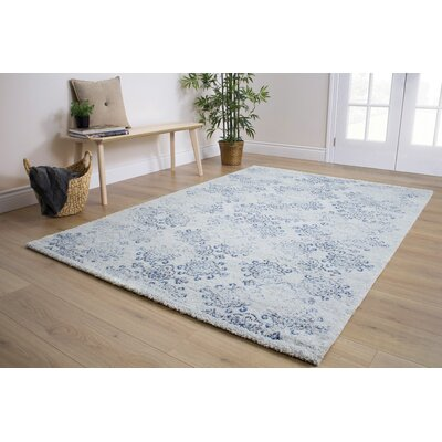 Colletta Faded Snowflakes Cream Area Rug Rug Size: 53 x 77