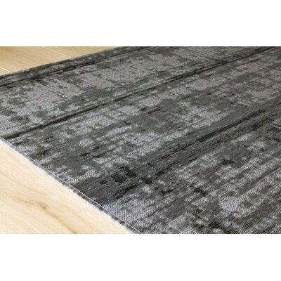 Finnegan Distressed Outdoor Gray Area Rug Rug Size: 80 x 112