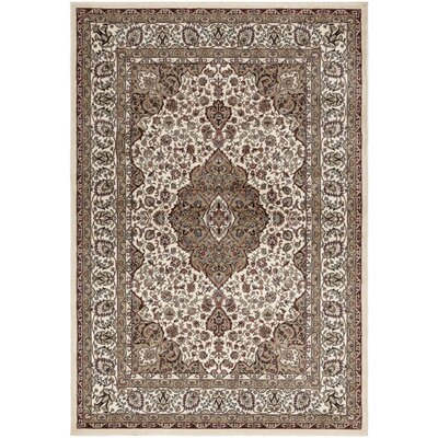 Regal Traditional Medallion Beige Area Rug Rug Size: 53 x 77