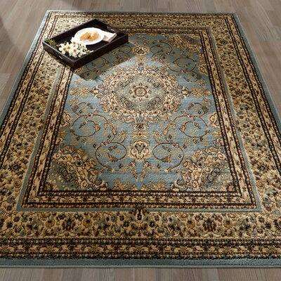 Royal Medallion Blue/Tan Area Rug Rug Size: 710 x 910