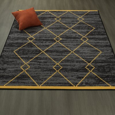 Heikkinen Diamond Trellis Black/Yellow Area Rugs Rug Size: 82 x 910