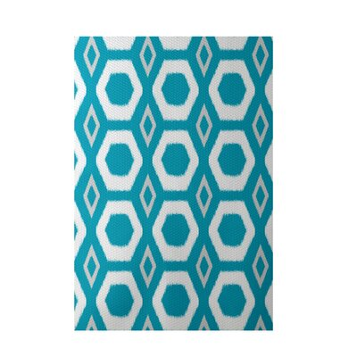 More Hugs and Kisses Geometric Print Caribbean Indoor/Outdoor Area Rug Rug Size: 5 x 7