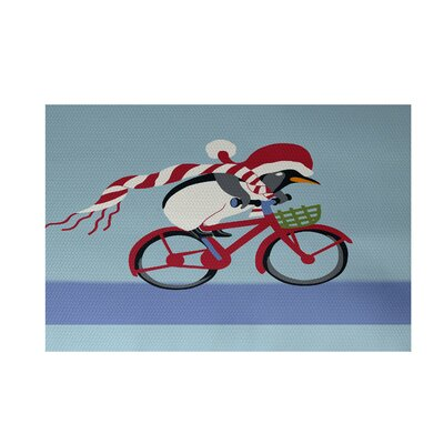 Pedaling Penguin Decorative Holiday Print Indoor/Outdoor Area Rug Rug Size: 2 x 3