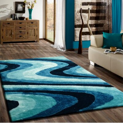 Osteen Shaggy Hand-Tufted Turquoise Area Rug Rug Size: Rectangle 76 x 103