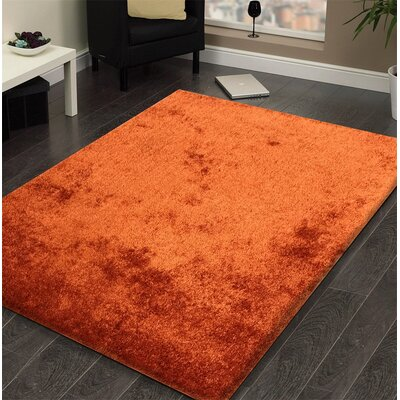 Heineman Solid Shag Hand-Tufted Orange Area Rug Rug Size: Rectangle 5 x 7