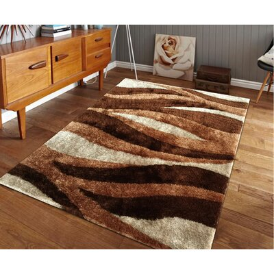 Lo-La Hand-Tufted Brown Indoor/Outdoor Area Rug Rug Size: 5 x 7