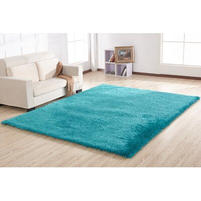 Housman Hand-Tufted Turquoise Area Rug