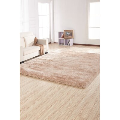 Heineman Solid Shag Hand-Tufted Beige Area Rug Rug Size: Rectangle 5 x 7
