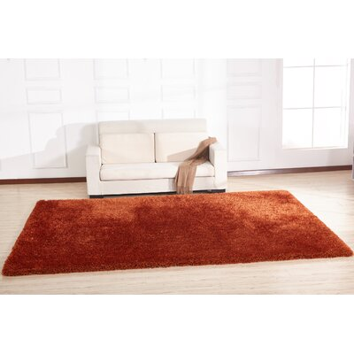 Heineman Solid Shag Hand-Tufted Orange Area Rug Rug Size: Rectangle 76 x 103