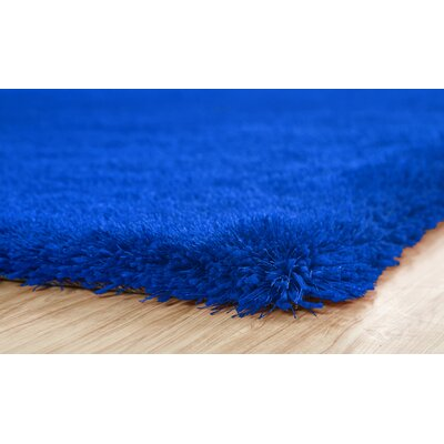Heineman Solid Shag Hand-Tufted Royal Blue Area Rug Rug Size: Rectangle 5 x 7