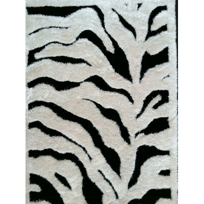 Trina Hand Tufted Black/White Area Rug Rug Size: Rectangle 76 x 103