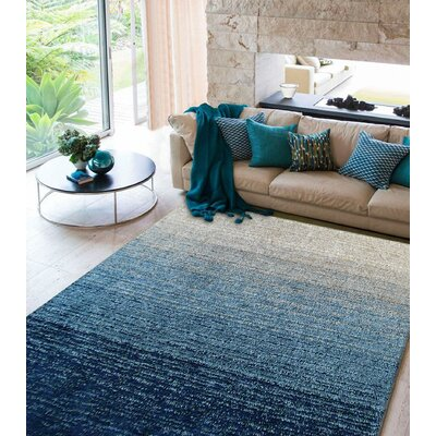 Hand-Tufted Teal/Beige Area Rug
