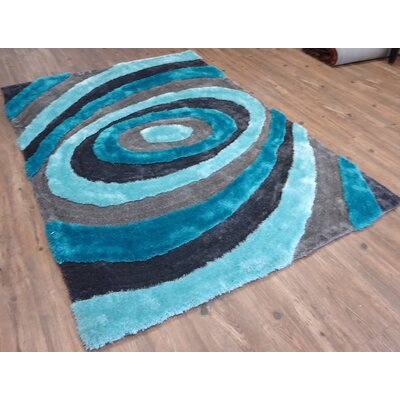 Clevinger Abstract Design Hand-Tufted Blue Area Rug Rug Size: Rectangle 76 x 103