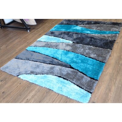 Clifton Abstract Design Hand-Tufted Turquoise Area Rug Rug Size: Rectangle 76 x 103