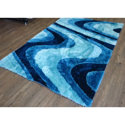 Clifford Abstract Design Hand-Tufted Turquoise Area Rug Rug Size: Rectangle 76 x 103