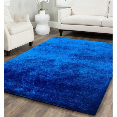 Heineman Solid Shag Hand-Tufted Royal Blue Area Rug Rug Size: Rectangle 76 x 103