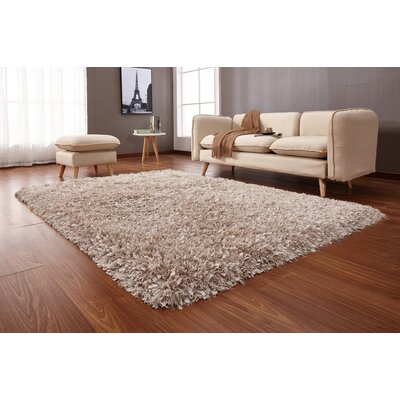 Heineman Solid Shag Hand-Tufted Beige Area Rug Rug Size: Rectangle 76 x 103