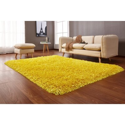 Heineman Solid Shag Hand-Tufted Yellow Area Rug Rug Size: Rectangle 5 x 7