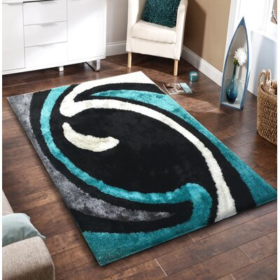 Lo-La Hand-Tufted Black/Blue Indoor/Outdoor Area Rug Rug Size: 5 x 7