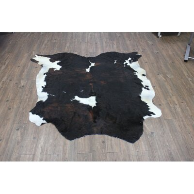 Thadine Hand-Woven Cowhide Black/Brown Area Rug