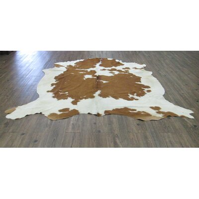 Wilbraham Hand-Woven Cowhide Brown/White Area Rug