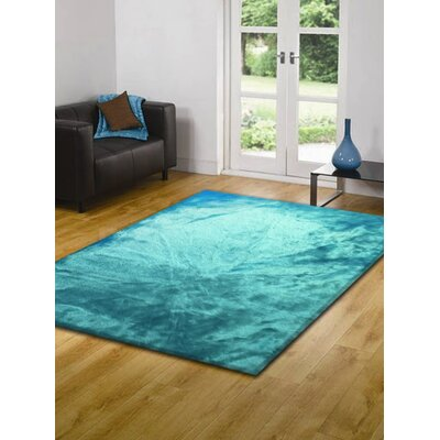Mizzone Faux Fur Turquoise Area Rug