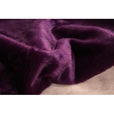 Ravius Faux Fur Purple Area Rug