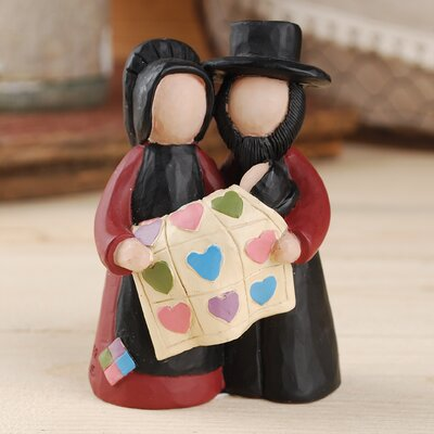 Amish Couple with Baby and Quilt Figurine AGGR5312 39347105