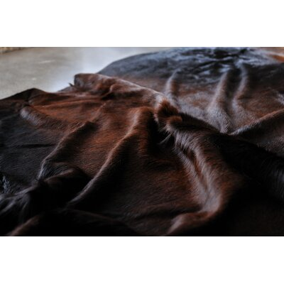 Abhinav Hand-Woven Cowhide Normand Area Rug