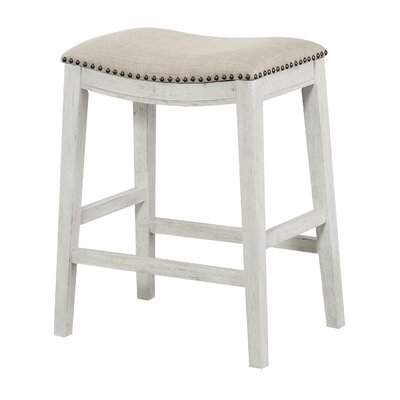 Clewiston Counter Saddle 24.75 Bar Stool Color: Antique White, Upholstery: Beige