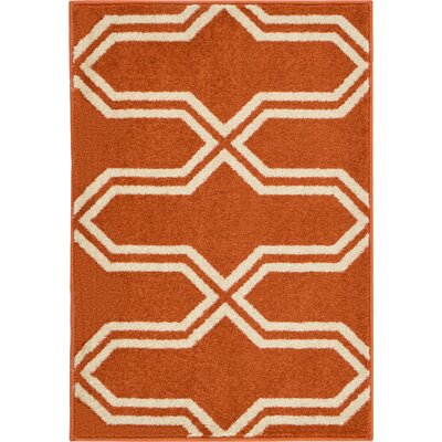 Marika Rust Red Area Rug Rug Size: Rectangle 22 x 3