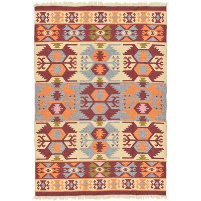 Izidora Traditional Cream Area Rug Rug Size: 66 x 93