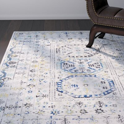 Downs Traditional Vintage Cream/Blue Area Rug Rug Size: Rectangle 93 x 126