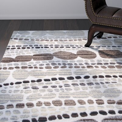 Jordon Ivory/Black Area Rug Rug Size: 52 x 73
