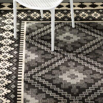 Tillis Black Outdoor Area Rug Rug Size: 67 x 96