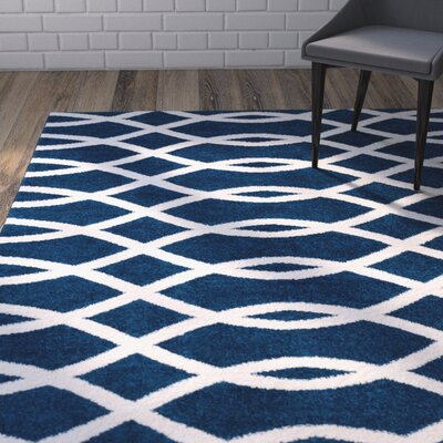 Mystic Poofy Modern Abstract Lines Blue Area Rug Rug Size: 710 x 910