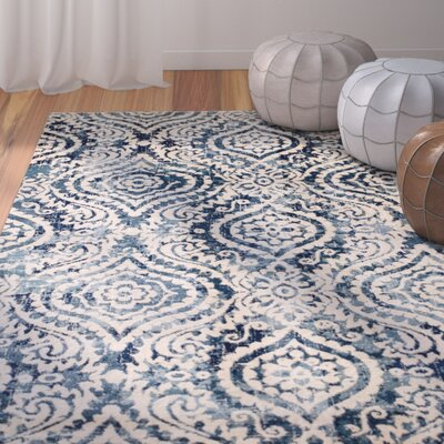 Amy Royal Trellis Cream/Blue Area Rug Rug Size: 74 x 106