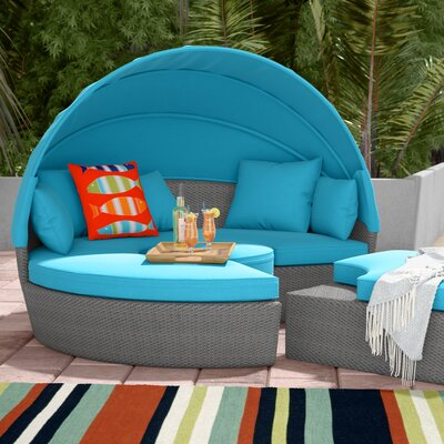 Churchill Luxurious Resort Style Daybed with Cushions Finish: Wicker/Blue Fabric