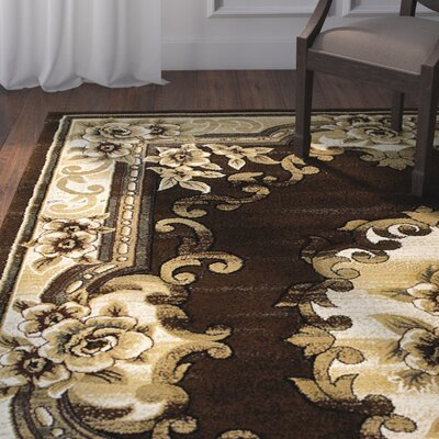 Rathburn Hand-Carved Chocolate/Beige Area Rug
