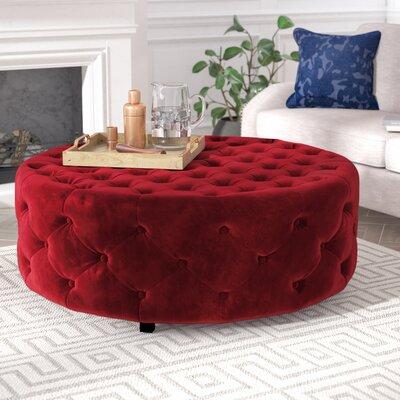 Aubin Round Ottoman Upholstery: Burgundy