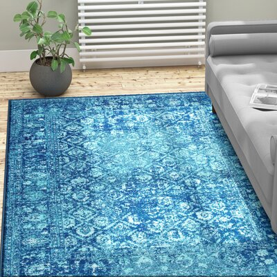 Moses Blue Area Rug Rug Size: 5' x 7'5