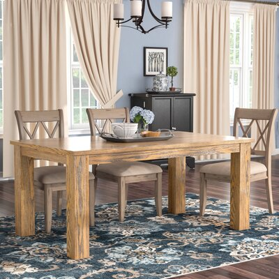 Raeann Dining Table Finish: Medium Brown